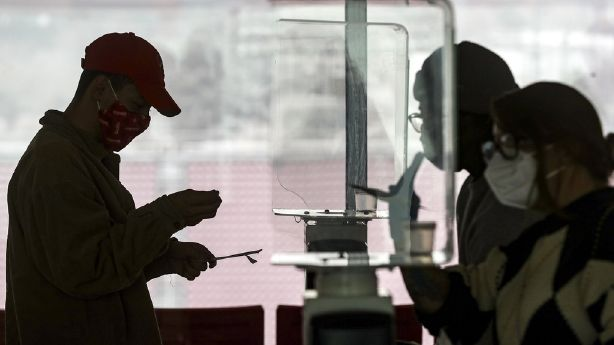 University of Utah student Justin Ellis prepares to swab his nostril for a rapid COVID-19 test at Rice-Eccles Stadium in Salt Lake City on Wednesday, Nov. 11, 2020. The university has launched an initiative to test 32,000 students for COVID-19 before the Thanksgiving break.