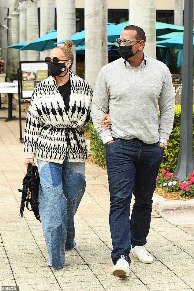 Outside: Jennifer Lopez and her fiancé Alex Rodriguez in Miami on Thursday